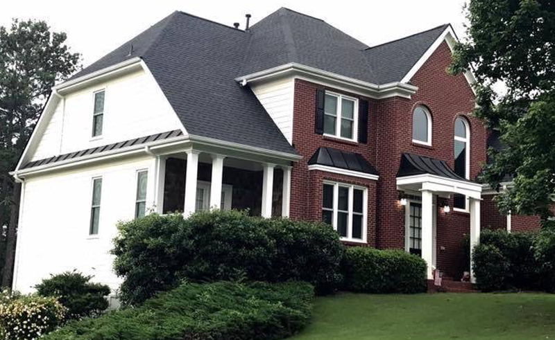 Two story home with gray tone asphalt shingles.
