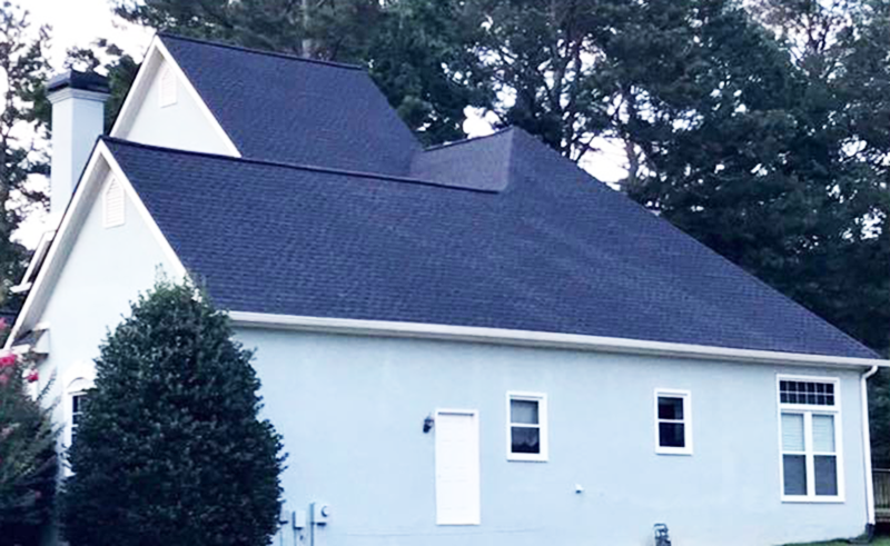 Exterior view of a house with a new roof
